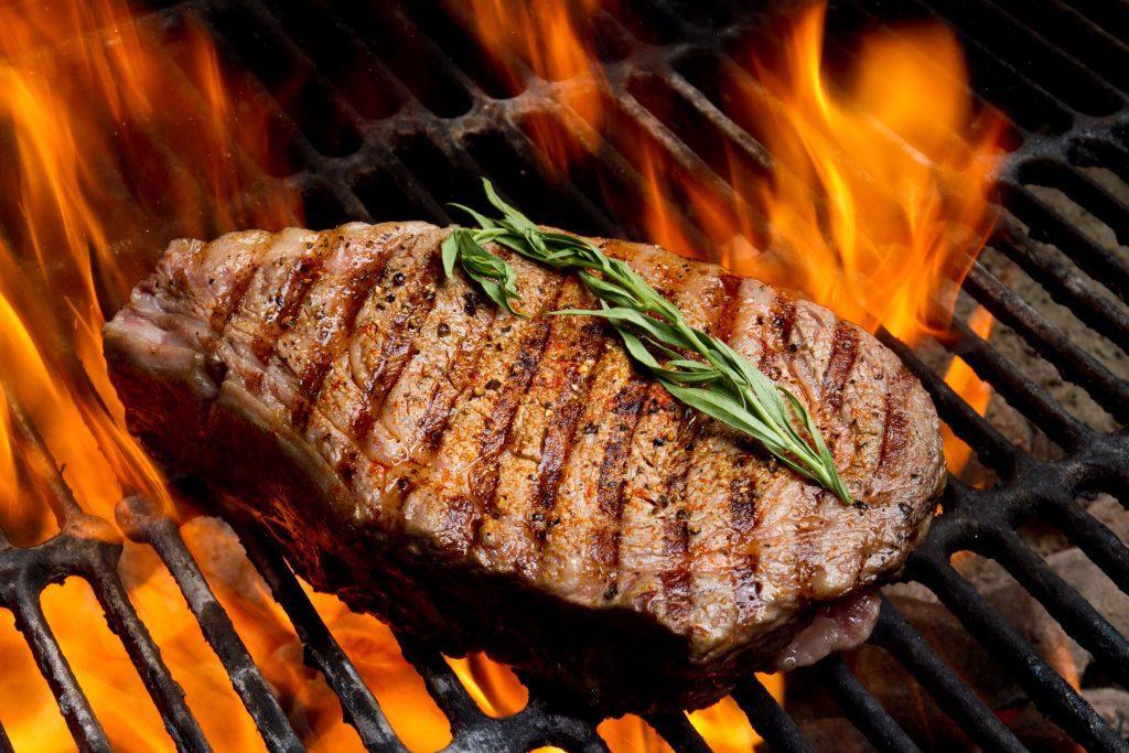 Juicy ribeye steak on the grill